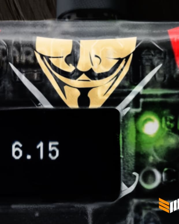 A Cold Card bitcoin hardware wallet, with a picture of Satoshi rendered as Guy Fawkes, and 6.15 BTC on it.