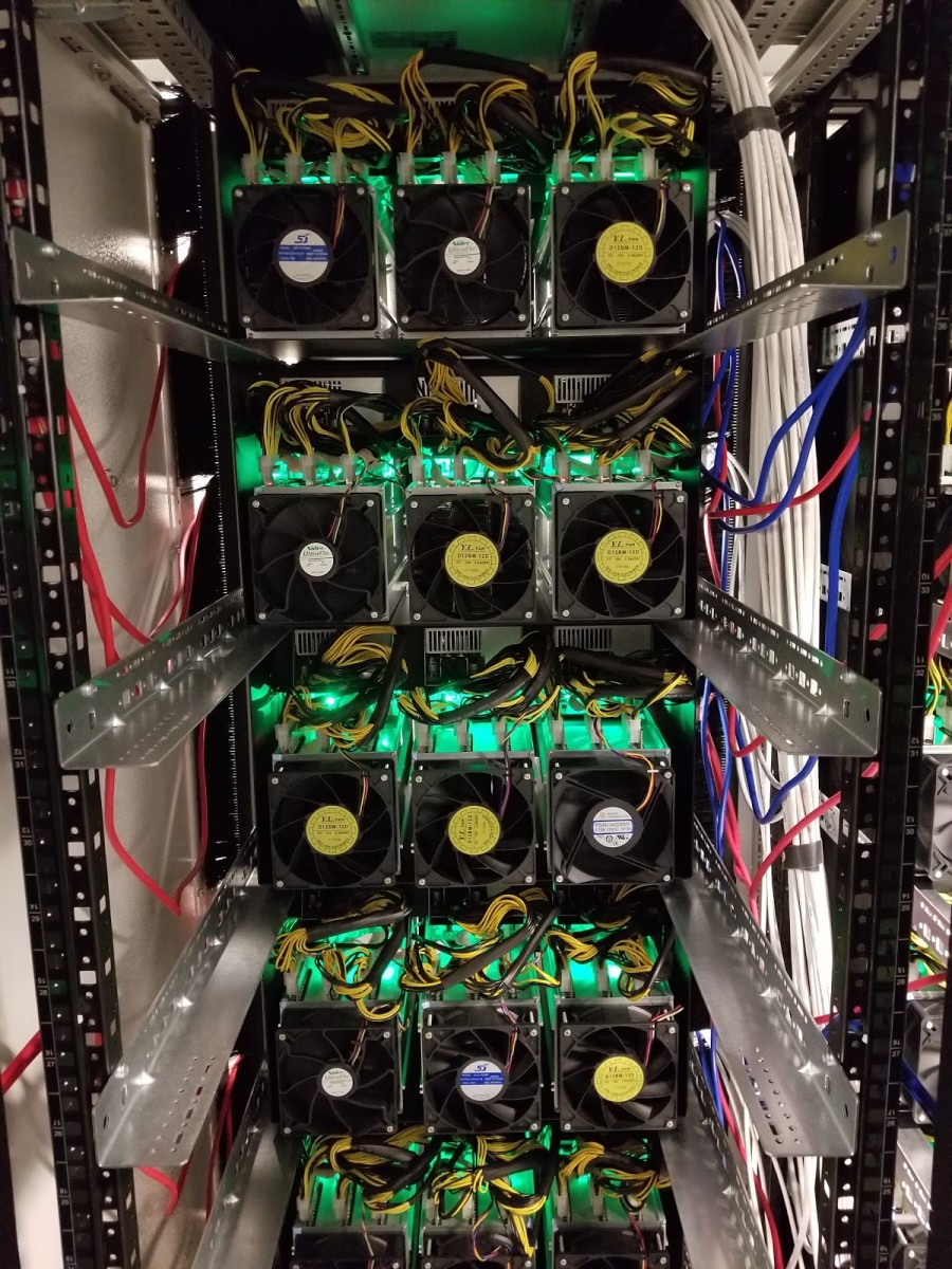 The backside of the mining rigs emit a powerful exhaust.