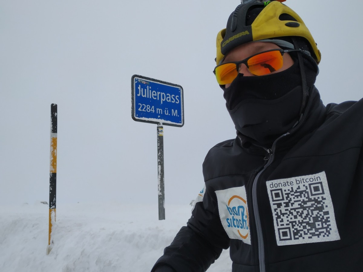 man skiing wearing bitcoin sweater