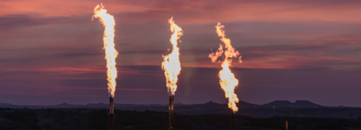 Flared gas over a peaceful sunset. Source.