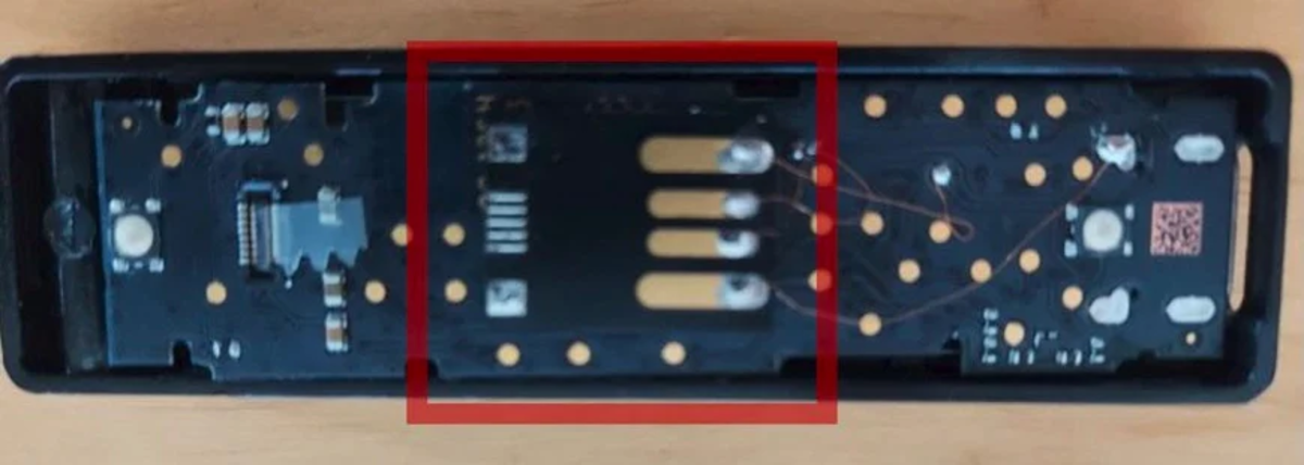 Back of tampered Ledger hardware wallet, red square by Grove. Source: BleepingComputer.